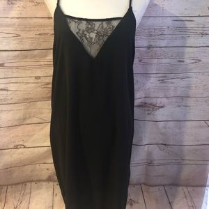 Black slip dress with lace detail